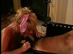 Blonde bitch in pink outfit fucks on couch and takes load on belly