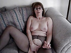 Mrs. Commish fingers herself on the love seat
